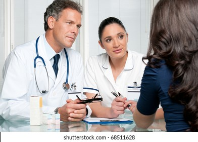 Young female patient discuss with doctors on her medical exam at hospital