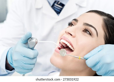 Young female patient whitening her teeth