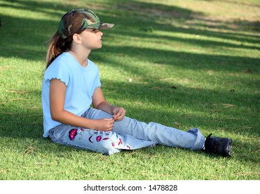 Young female player relaxing on the grass