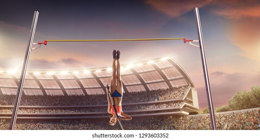 Young female pole vault athlete with pole bar. Women in sport clothes jump over the pole bar at athletic sport track in professional stadium