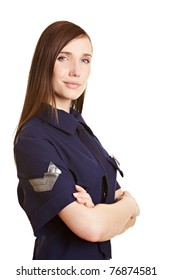 Young female police officer smiling with arms crossed