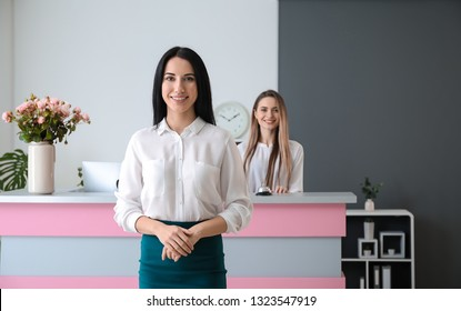Young female receptionist in hotel