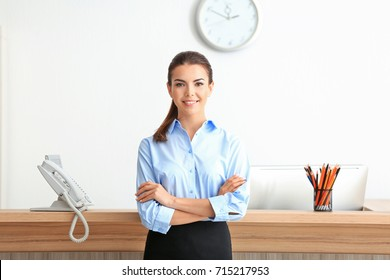Young female receptionist working in office