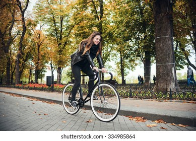 young female riding a bicycle, girl with fixed gear bike