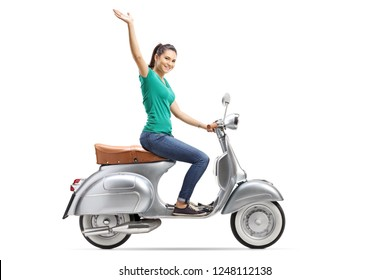 Young female riding a vintage scooter and waving isolated on white background