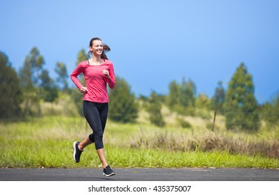 Young female running outdoors.