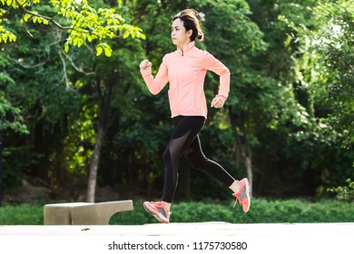 young female running in the park