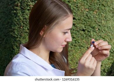 Young female scientist biologist on plants background Portrait