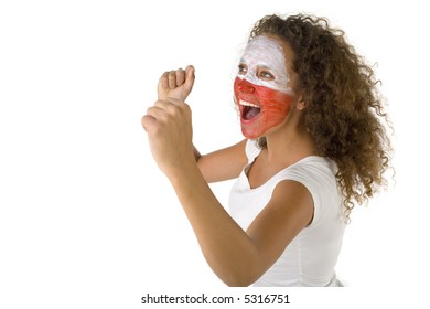 Young female screaming fan with painted Polish flag on face. She's on white background. Side view.
