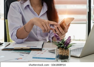Young female secretary holding phone for contact customer meeting schedule. Business portrait concept.