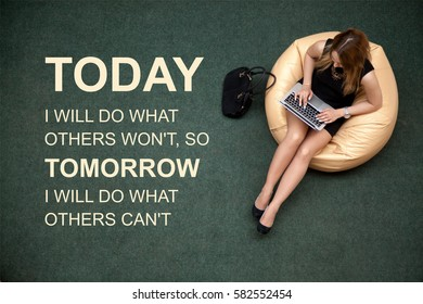 """Young female sitting on bean bag working on laptop in public wifi area. Photo with motivational text """"Today I will do what others will not, so tomorrow I will do what others can not"""""""