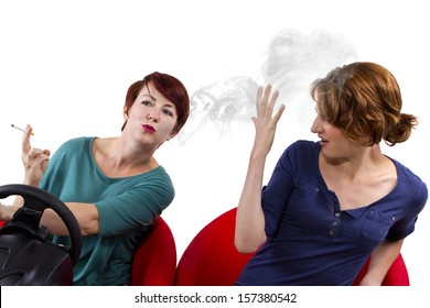young female smoking while driving on white background