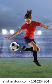 Young female soccer player in action inside large stadium