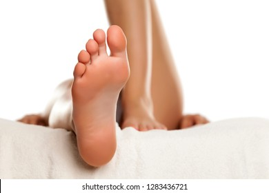 Young female sole feet on white background
