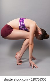young female stretching in the studio