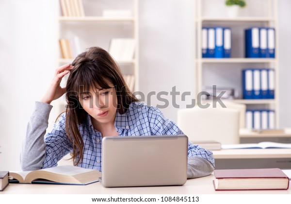 Young female student in educational concept
