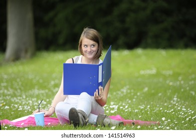 young female student in the  park