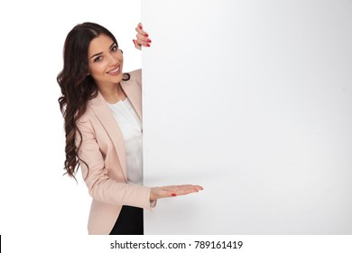 young female student presenting a blank billboard on white background