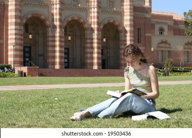 Young female student is reading in the campus