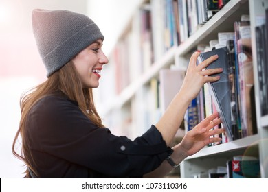 Young female student studying in the library