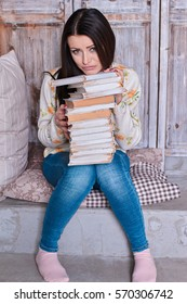 Young Female Studying A Text Book