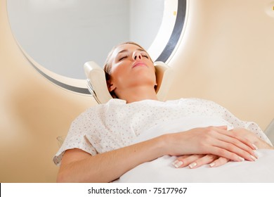 A young female taking a CT scan - medical testing
