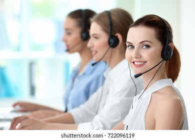 Young female technical support dispatcher working in office