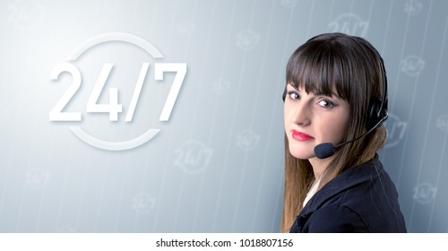 Young female telemarketer with a 24/7 sign next to her