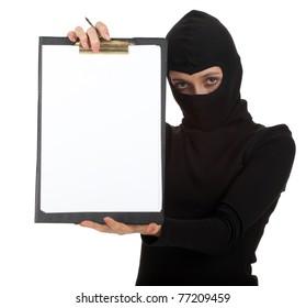 young female thief in black balaclava keeping blank clipboard