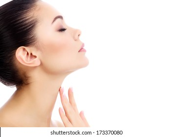 Young female touches her neck, white background, copyspace