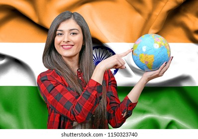 Young female Tourist holding Earth Globe against flag of India