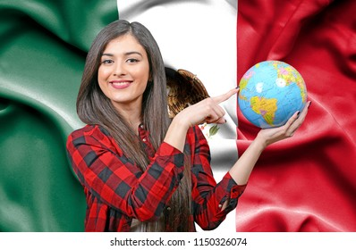 Young female Tourist holding Earth Globe against flag of Mexico