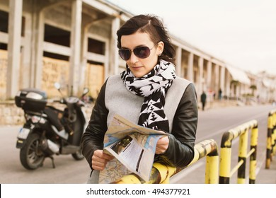 Young female tourist with a map