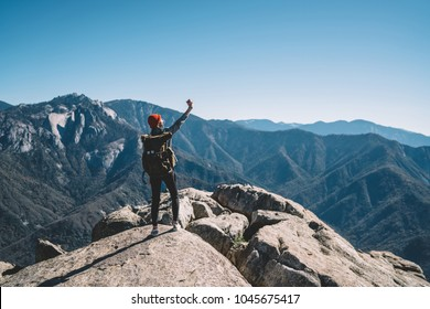Young female travel blogger making selfie using smartphone on top of mountain on breathtaking scenery, girl wanderlust using telephone for making picture during hiking tour getting to destination