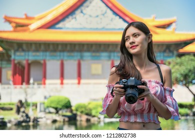 Young female travelers visit Taipei historical building attraction Chiang Kai-shek Memorial Hall in Taipei, Taiwan