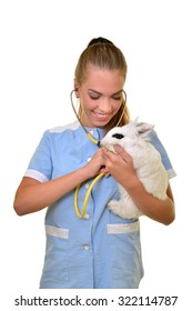 young female veterinarian doctor carrying a rabbit