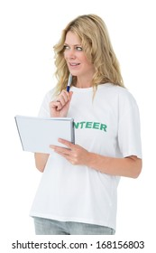 Young female volunteer writing a note over white background