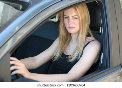 young female woman driver with sight problems in a car