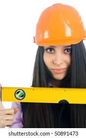 Young female worker with protection helmet and level at isolated background