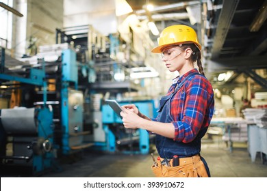 Young female worker using touchpad