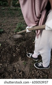 Young female working in a garden