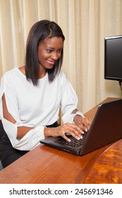 Young Female working on her laptop
