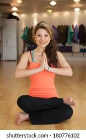 young female in yoga studio