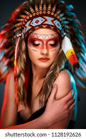 Young feminine Indian American female with colorful feather hat