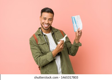 Young filipino man holding an air tickets