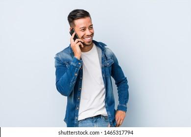 Young filipino man talking on phone