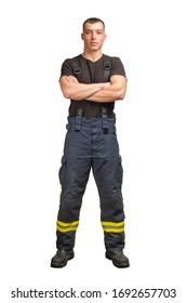 Young firefighter with folded arms wearing black t-shirt and fireproof pants with suspenders isolated on white background