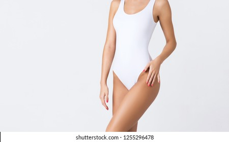 Young, fit and beautiful girl in sporty swimsuit. Sport, diet, health and beauty concept.