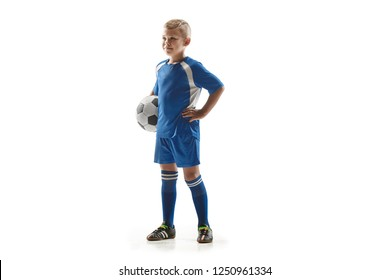 Young fit boy with soccer ball standing isolated on white. The football soccer player on studio background.