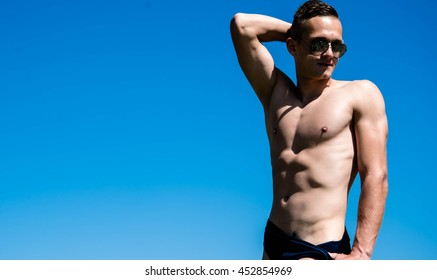 Young, fit and handsome man with athletic and muscled body